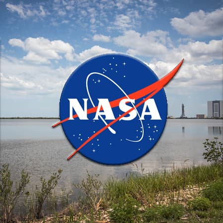 NASA Logo with VAB in distance
